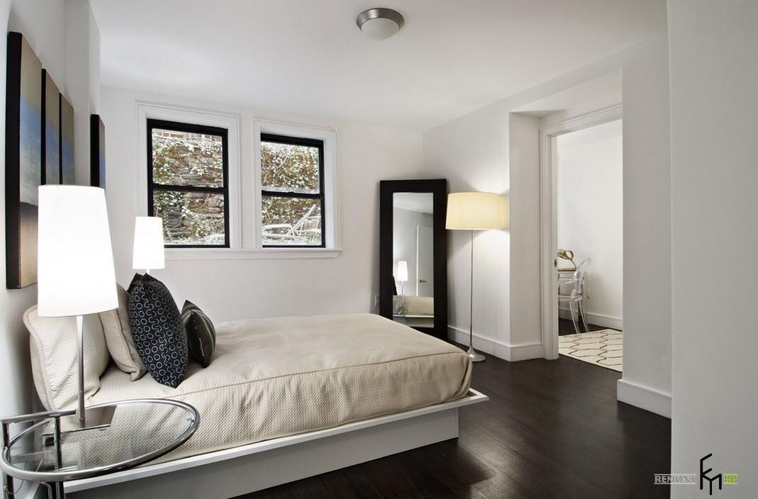 Черные оконные рамы в комнате