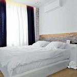 Отделка стен искусственным камнем в спальне