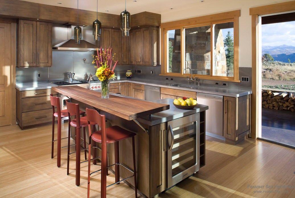 Современный дизайн угловой кухни с барной стойкой
