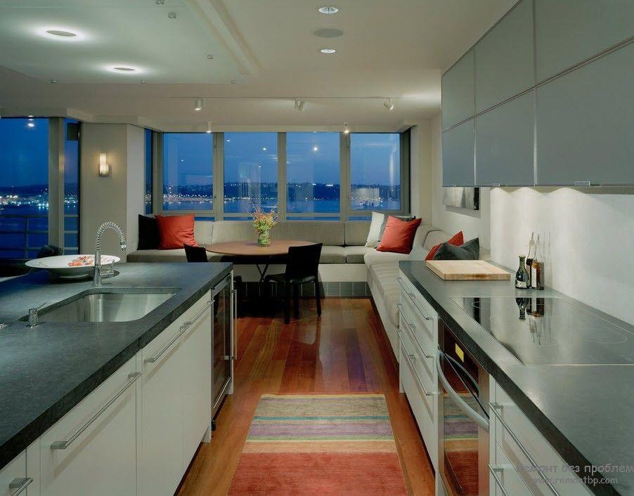 Уютный и комфортный интерьер гостиной, совмещенной с кухней