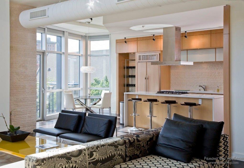 Удобство и комфорт в дизайне гостиной, совмещенной с кухней