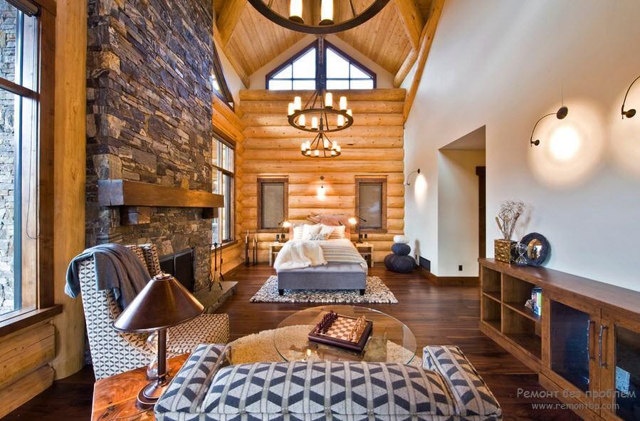 Изысканная спальня с декоративным камнем в интерьере