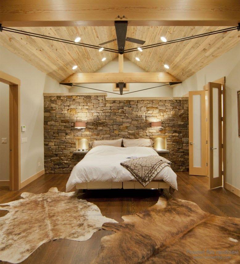 Спальня, со вкусом оформленная камнем
