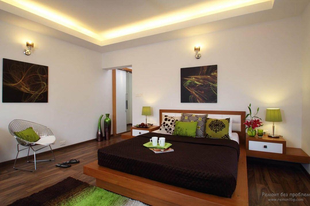 темная мебель в спальне с приглушенными фисташковым и оливковым оттенками