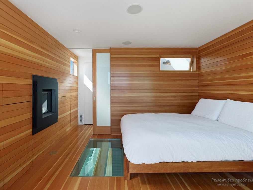 Эксклюзивный дизайн спальни с использованием одного цвета с отделкой под дерево