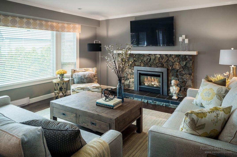 Современный дизайн зала с камином