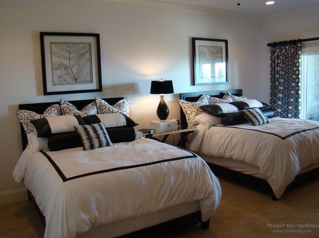 Эффектный черно-белый интерьер детской комнаты для двоих детей
