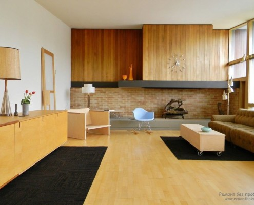 В оформлении интерьера применены дерево, искусственный камень, текстиль