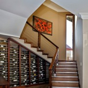 Винные полки под лестницей