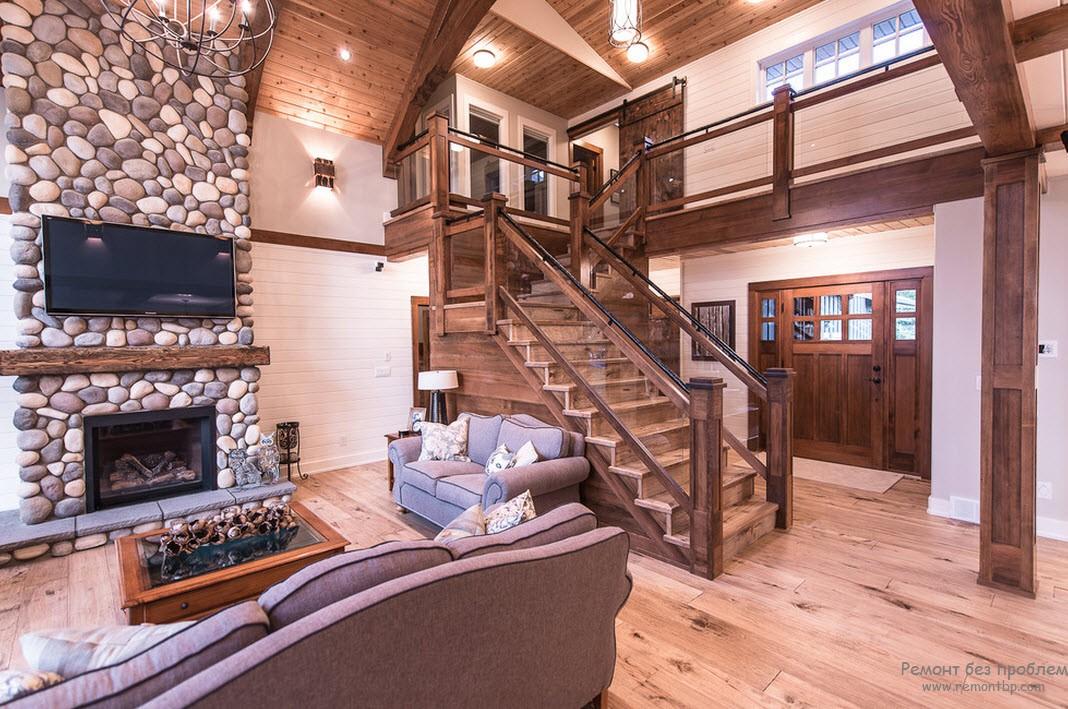 Красивый деревянный коттедж с жекоративным камнем в интерьере