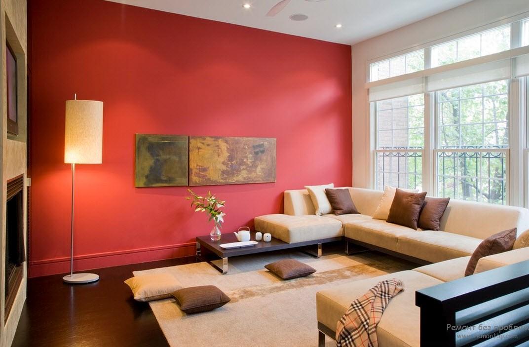 Красные стены в интерьере гостиной