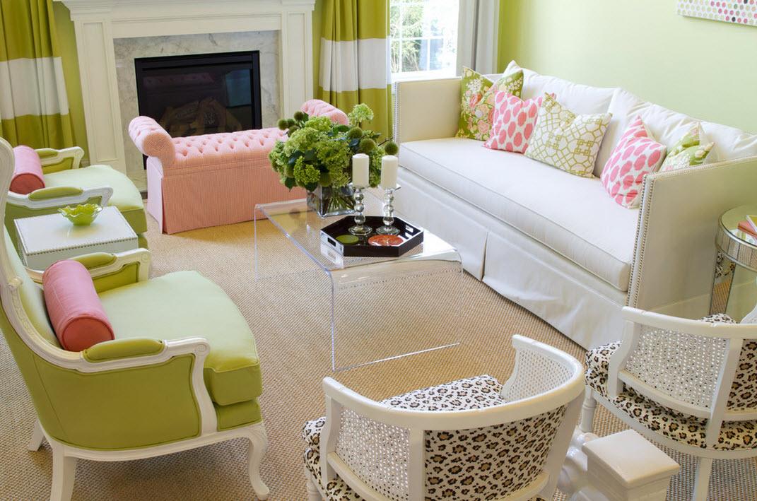 Весеннюю свежесть в гостиной создают зеленый оттенок ближе к оливковому в сочетании с нежно-розовым и белым