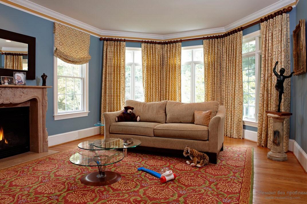 Кресло подобрано пр цвету с закругленными формами и низкой спинкой  - отличное место для чтения и отдыха