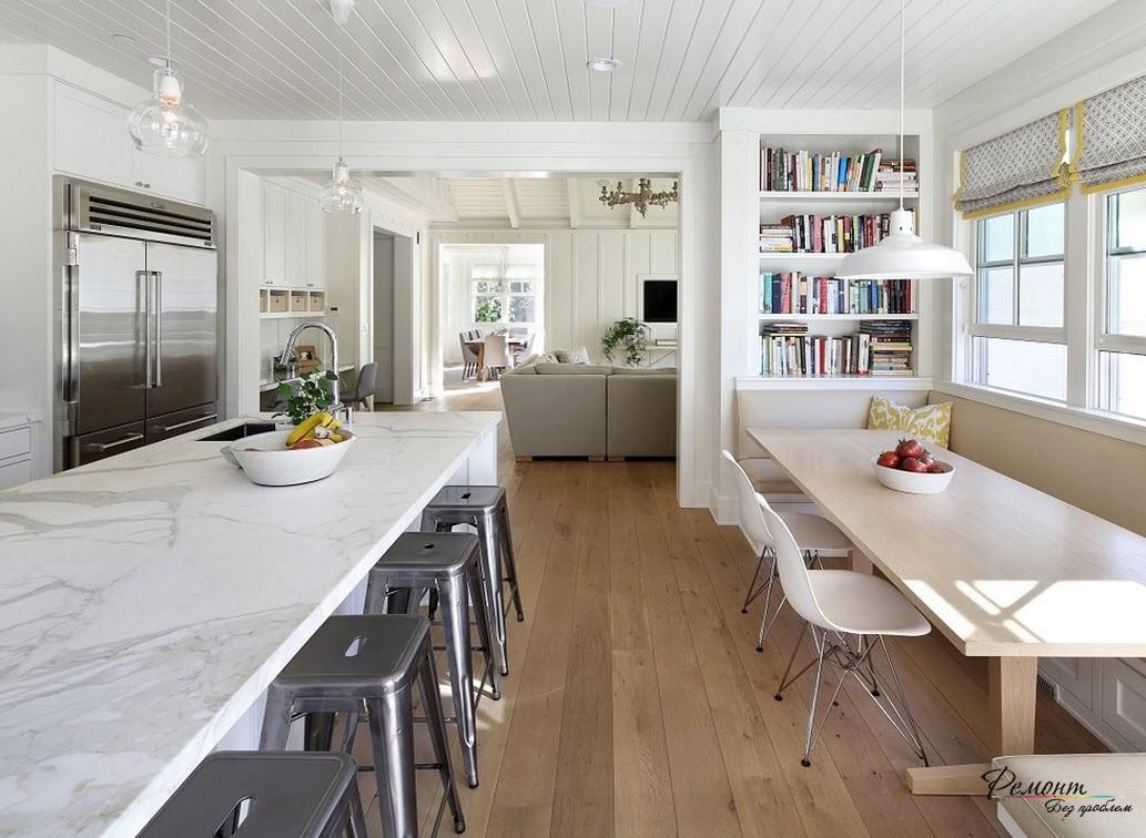 Дизайн кухни-столовой, плавно переходящей в гостиную