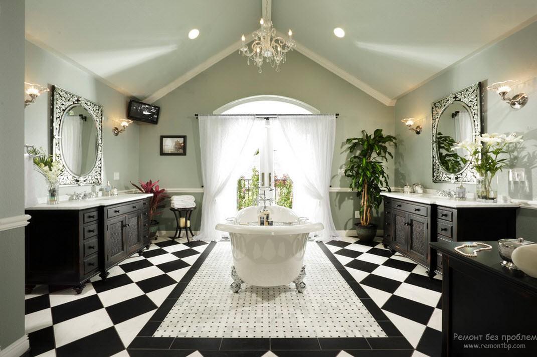 Роскошный интерьер ванной комнаты в черно-белых тонах с зеркалами в серебристой раме