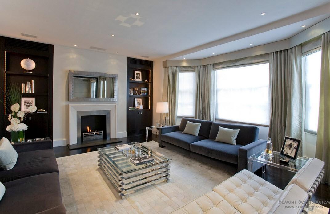 Цвет штор повторяет тональность мебели и гармонично сливается с оформлением гостиной