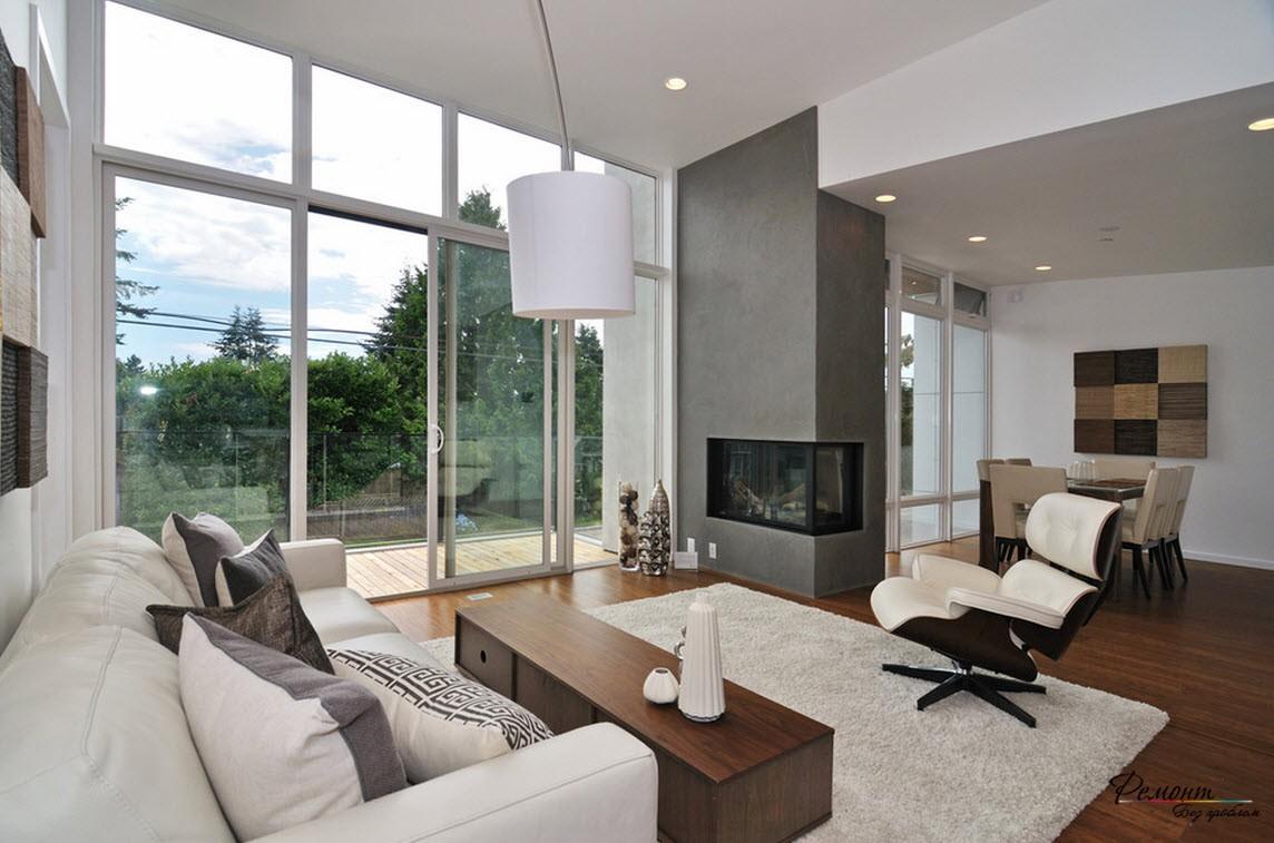 Дизайн современной гостиной с угловым камингом в интерьере