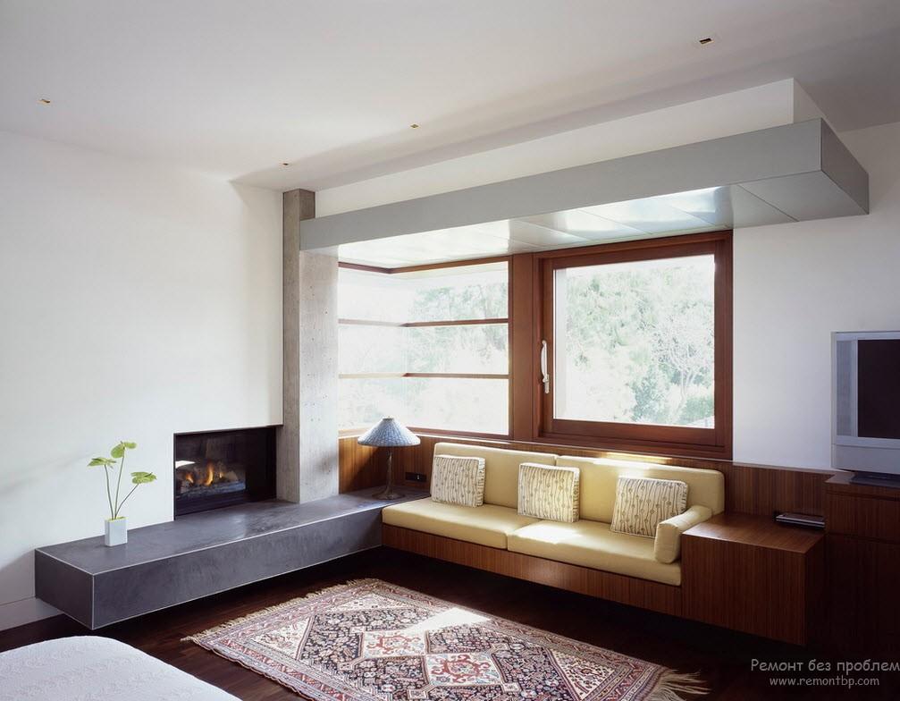 Интерьер в стиле техно и соответствующий ему диван возле окна