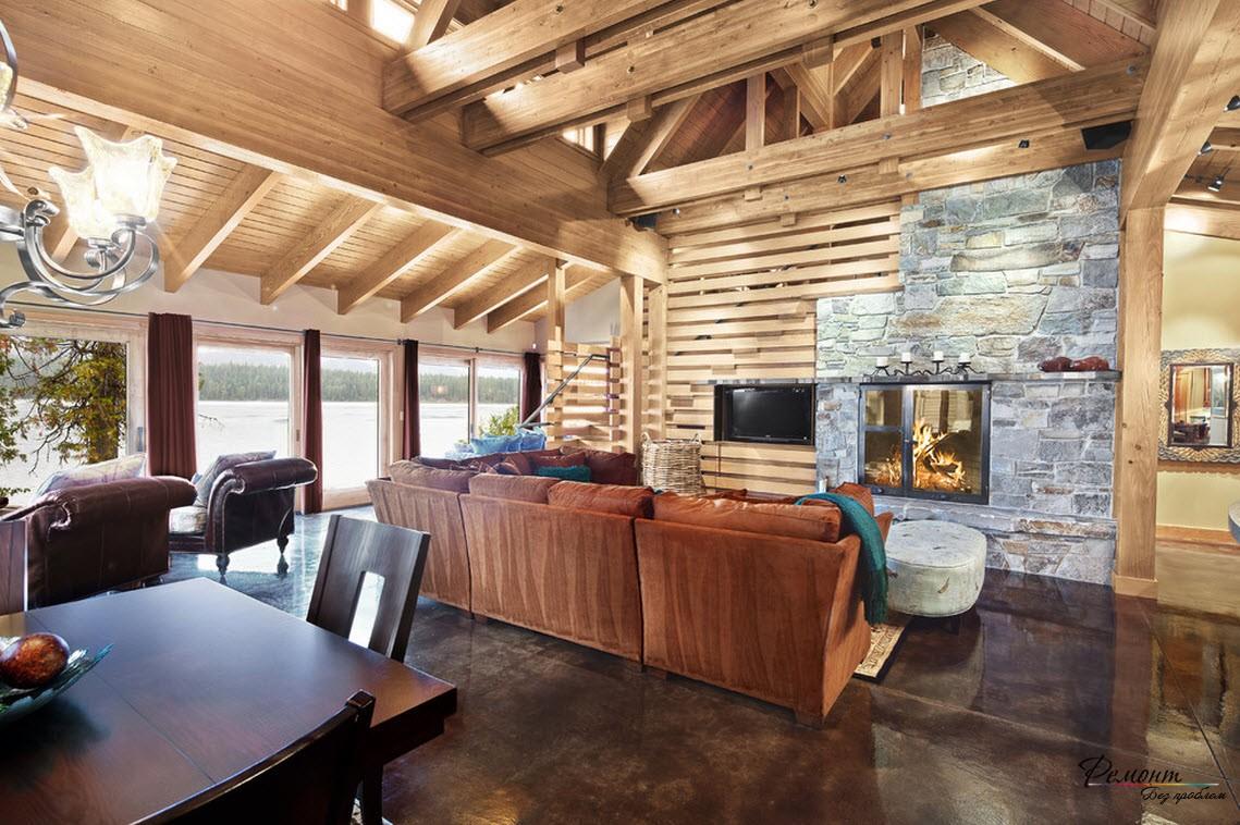 Интерьер загородной гостиной, приближенной к природе с ипользованием дерева и камня