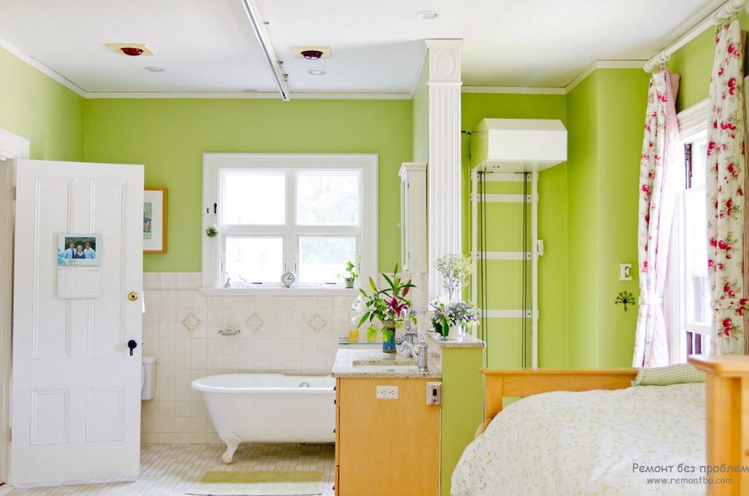 Бело-зеленое сочетание с добавлением оранжевого приглушенного в интерьере ванной комнаты