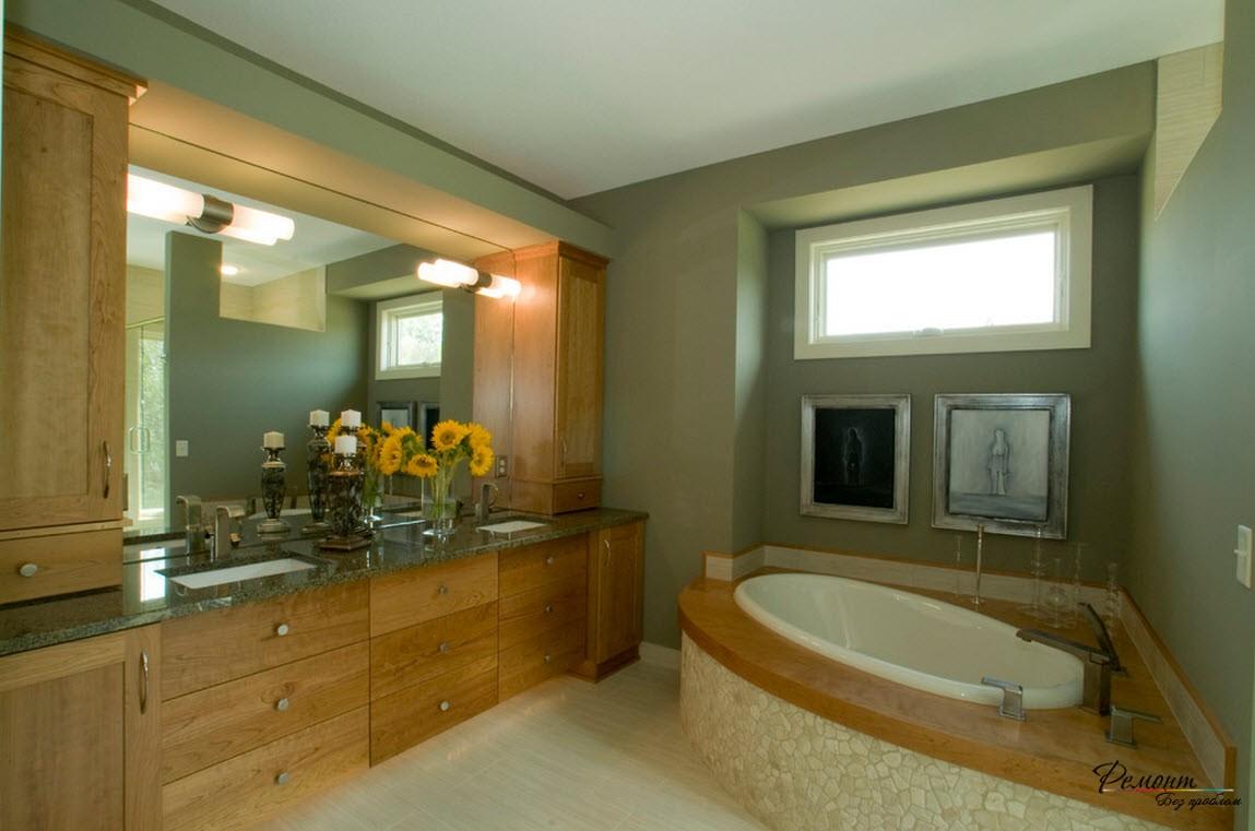 Средняя угловая ванна хорошо вписалась в интерьер в природном стиле