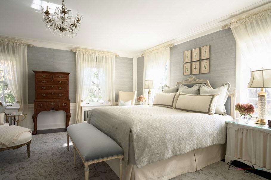 Интерьер спальни, где использовано сочетание светло-серого оттенка  с белым
