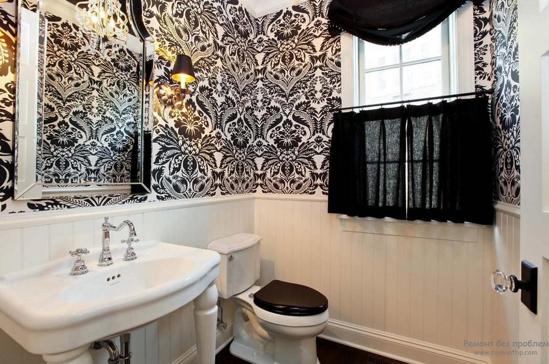 Оригинальный рисунок на стенах черн-белой ванной