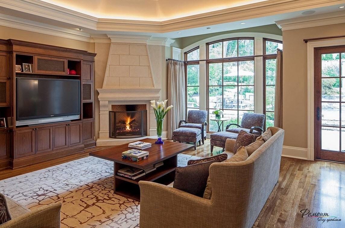 Эффектная гостиная, где в качестве отделочного материала камина, как и стен, применена штукатурка