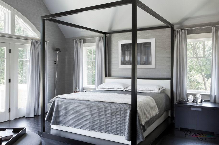 Нейтральная серо-белая спальня успокаивает и расслабляет