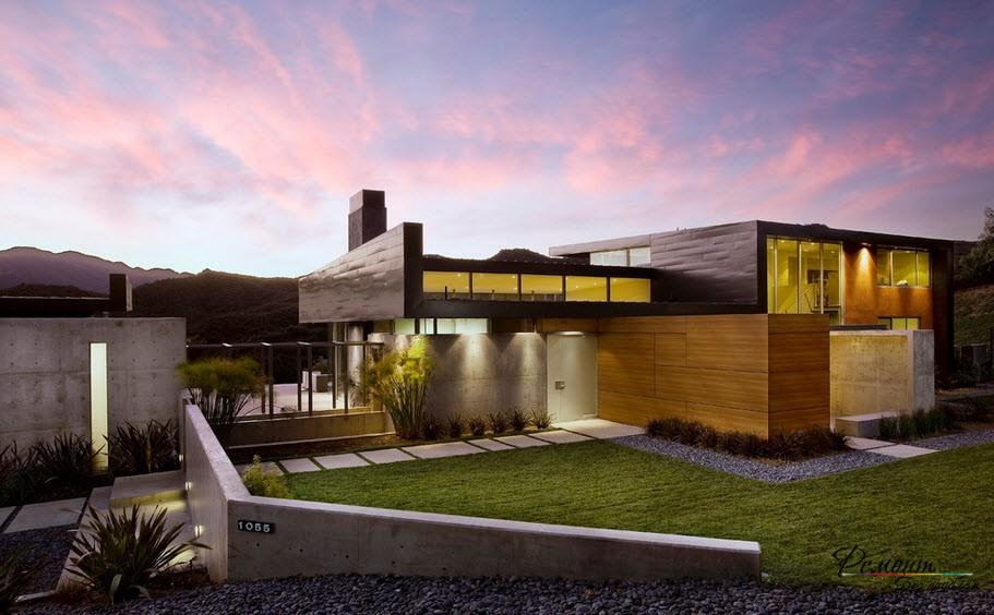 Участок с газонои и домом с плоской крышей