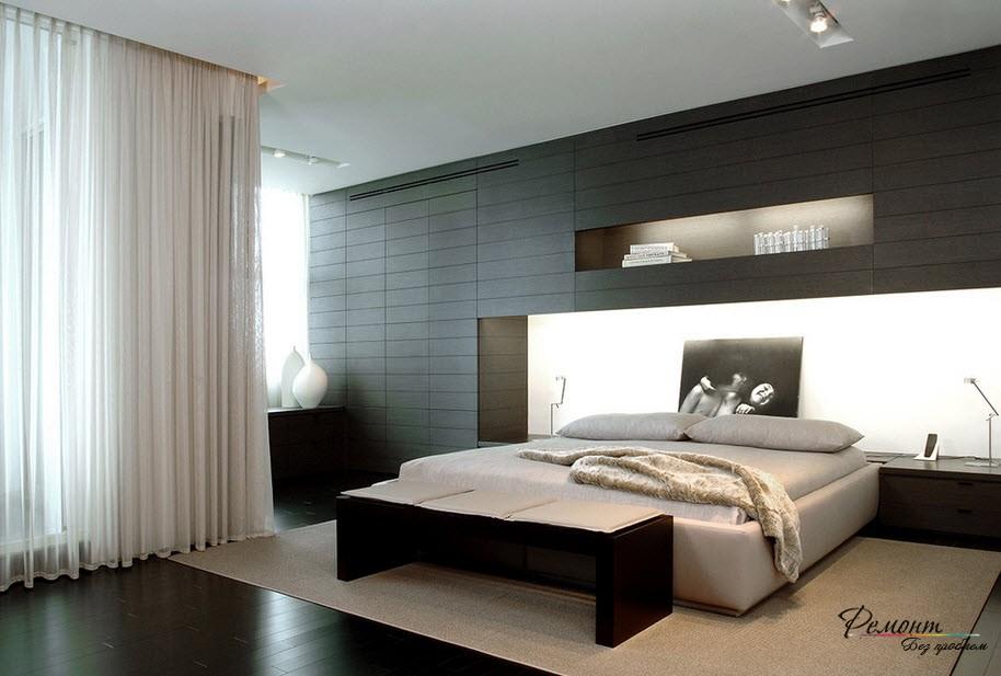 Спальня, оформленная темным ламинатом