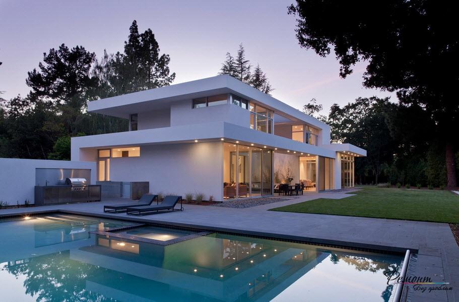 Дом с плоской крышей у бассейна