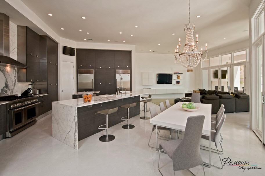 В современном дизайне четко прослеживается тенденция к объединению пространства кухни с гостиной