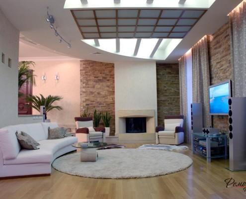 Необычное решение потолка для круглой гостиной