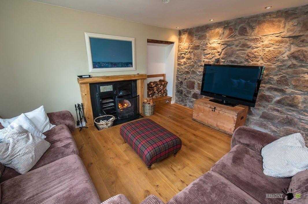 Традиционный Шотландский домик у моря в стиле кантри