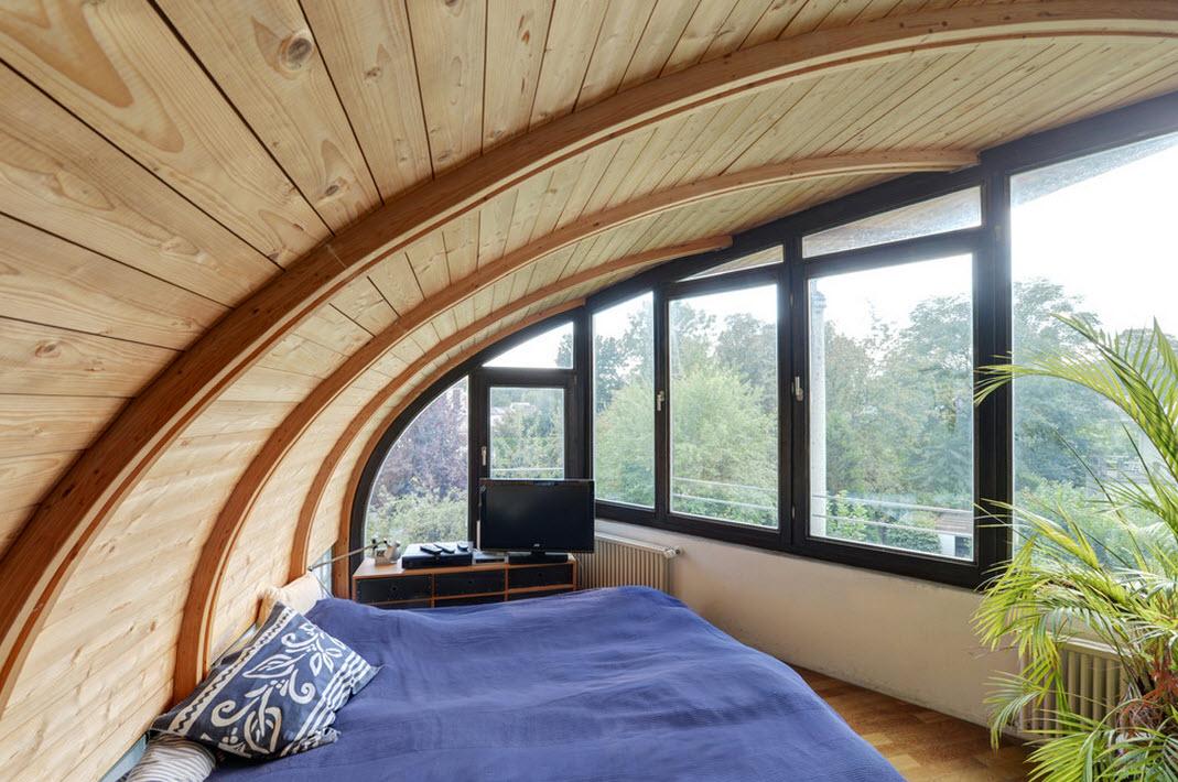 Округлые формы потолка в спальне