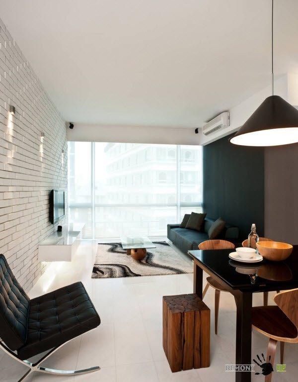 Темная мебель в черно-белом интерьере