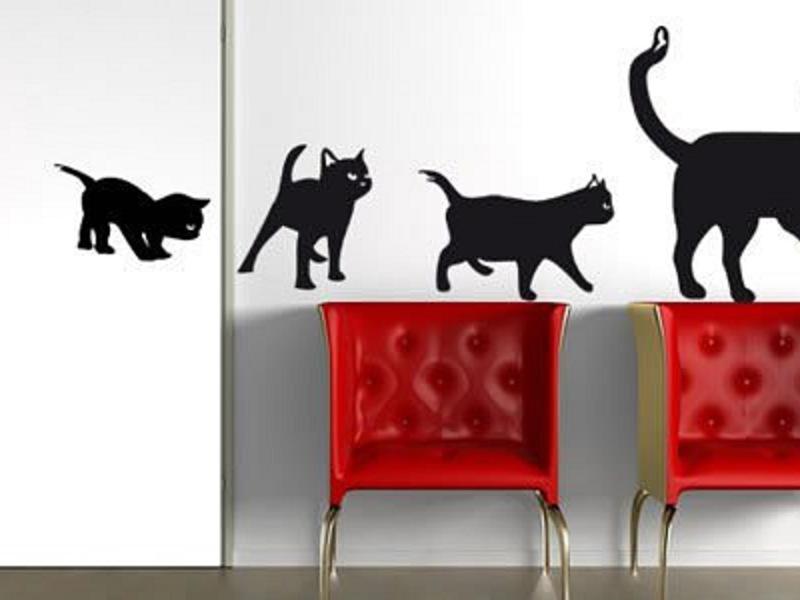 черные кошки на светлом фоне