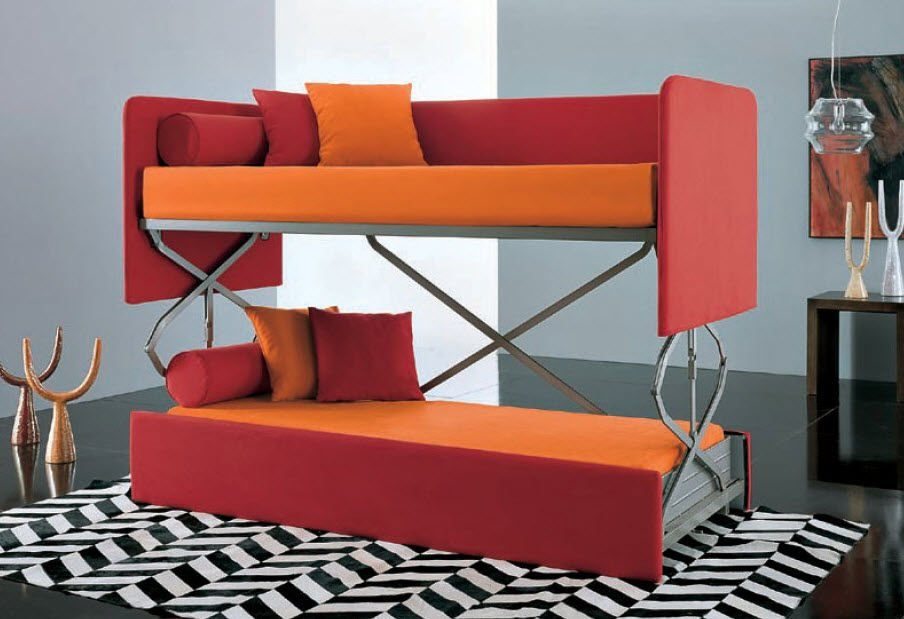 gorgeous-red-and-orange-couch-that-turn-into-bed-design-with-pillows-on-chevron-patterned-area-rug-in-gray-room