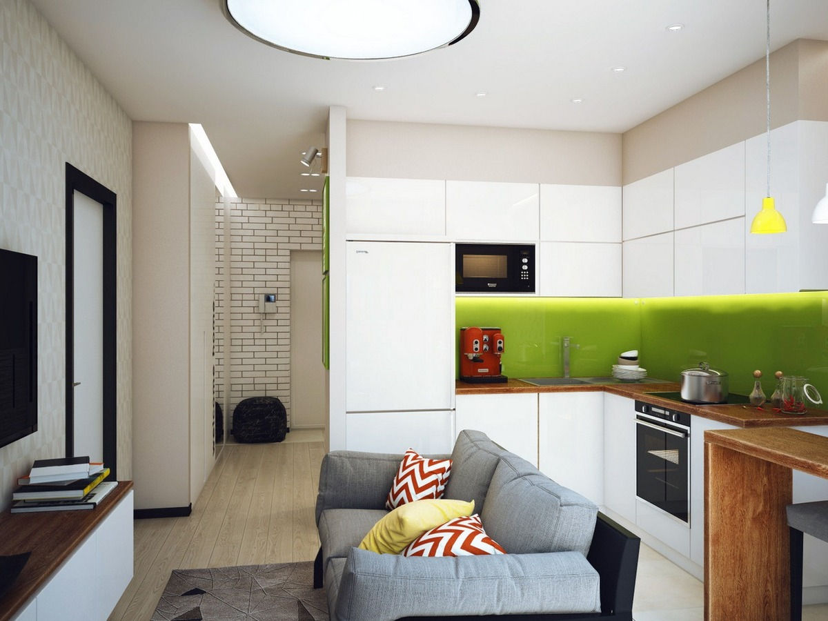 небольшая кухня-гостиная с зелеными тонами