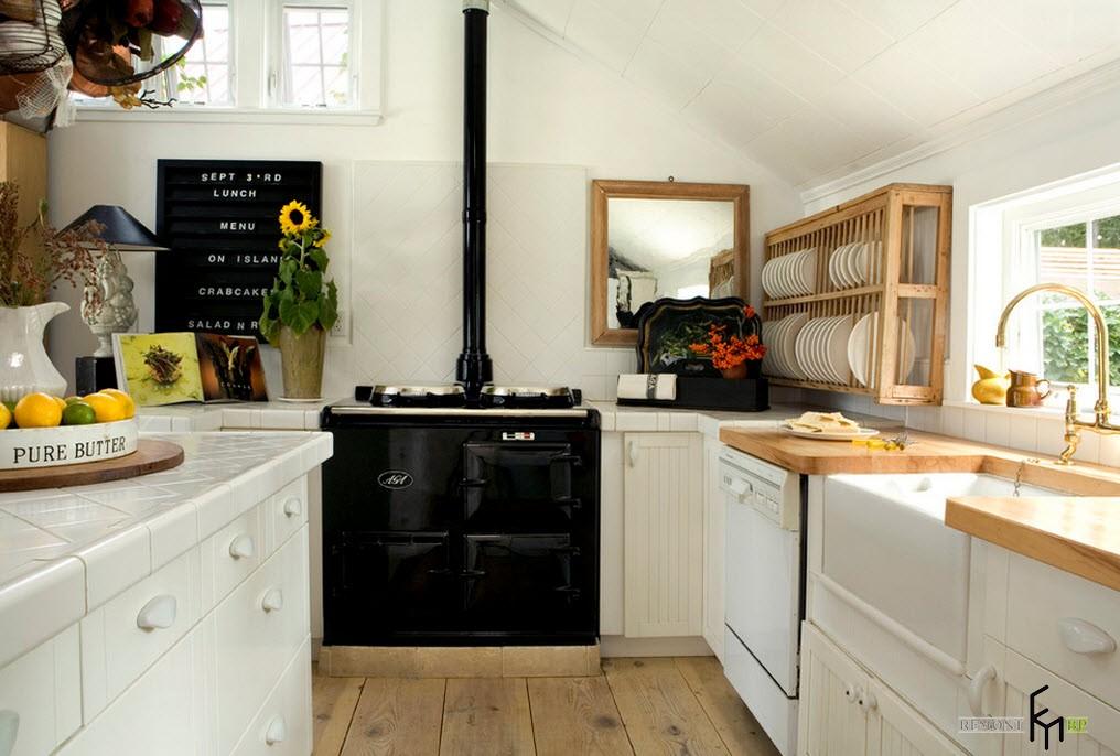 Черная плита в кухне скандинавского стиляЧерная плита в кухне скандинавского стиля