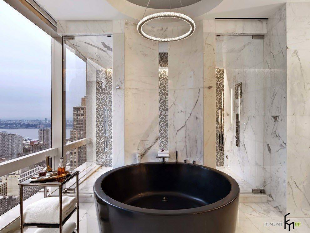 Черная и круглая ванна