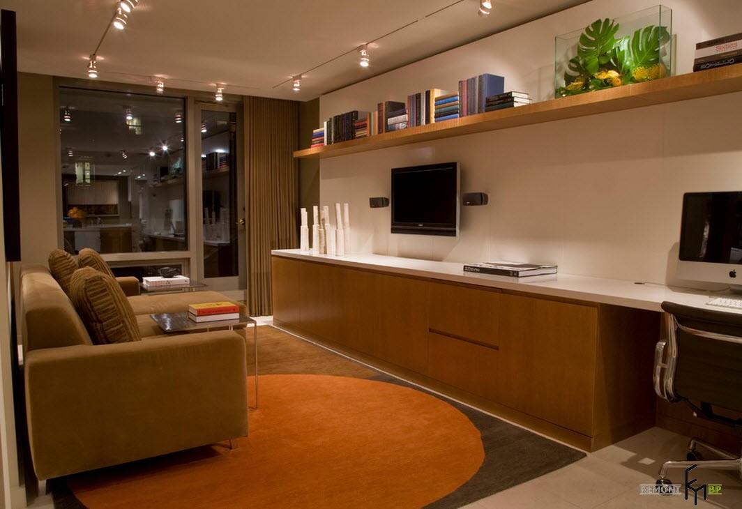 Телевизор не стене в кухне-гостиной